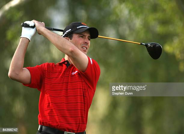 Mike Weir of Canada hits his tee shot on the second hole on the Palmer Private Course at PGA West during the first round of the Bob Hope Chrysler...
