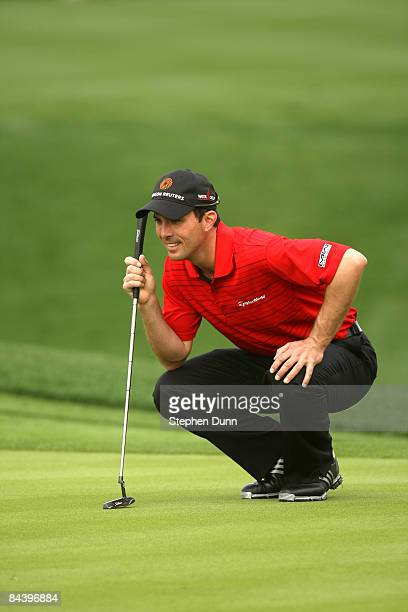 Mike Weir of Canada lines up his putt on the eighth hole on the Palmer Private Course at PGA West during the first round of the Bob Hope Chrysler...