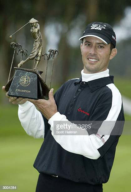 Mike Weir of Canada poses with the trophy after a one-stroke victory at the Nissan Open on February 22, 2004 at Riviera Country Club in Pacific...