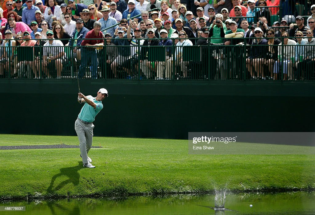 Mike Weir of Canada skips the ball across the pond on the 16th hole during a practice round at Augusta National Golf Club on April 8, 2014 in Augusta, Georgia.