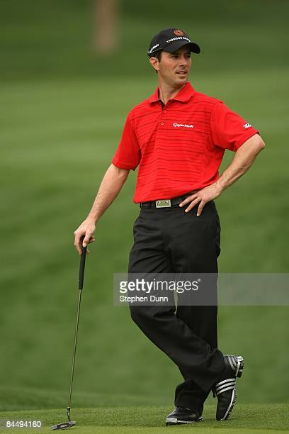 Mike Weir of Canada waits to putt on the seventh hole on the Palmer Private Course at PGA West during the first round of the Bob Hope Chrysler...