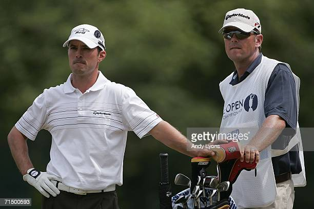 Mike Weir of Canada waits to tee off on the 5th hole with his caddy Brennan Little during the third round of The Open Championship at Royal Liverpool...