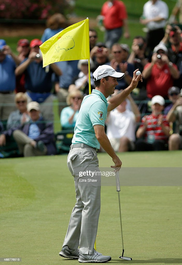 Mike Weir of Canada waves to the crowd after he hit a hole-in-one on his second tee shot on the 16th hole during a practice round at Augusta National Golf Club on April 8, 2014 in Augusta, Georgia.