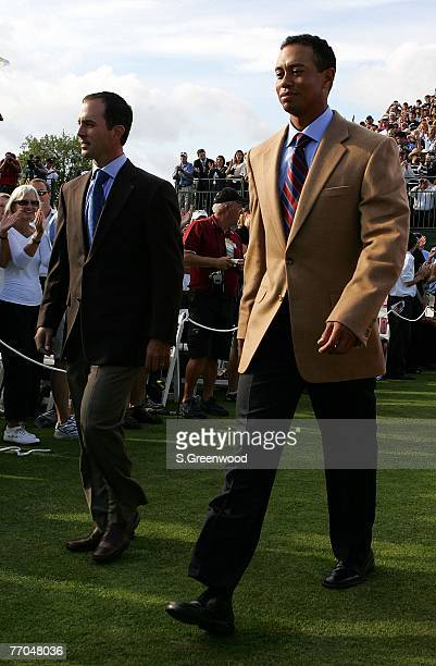 Mike Weir of the International Team walks to the stage with Tiger Woods of the U.S. Team during the opening ceremonies prior to the start of The...