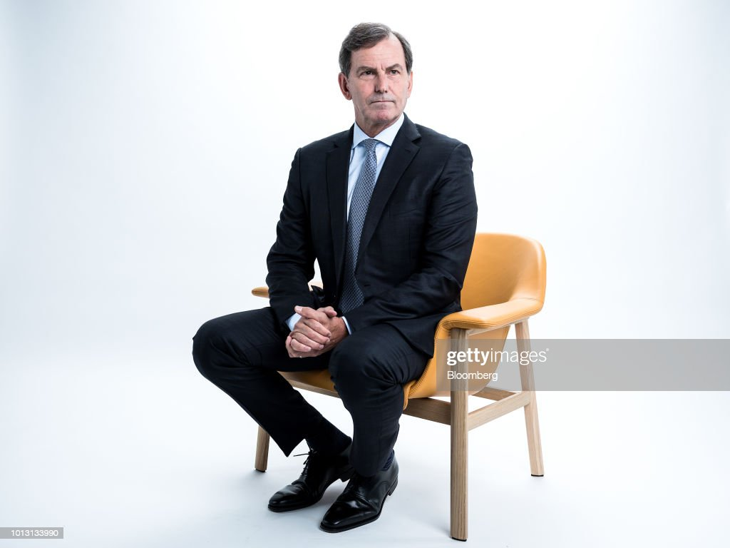 Mike Wells, chief executive officer of Prudential Plc, poses for a photograph following a Bloomberg Television interview in London, U.K., on Wednesday, Aug. 8, 2018. Prudential reported that first-half profit from its Asian operations soared 14 percent to 1.02 billion pounds ($1.3 billion) on a constant exchange rate basis, ahead of a spinoff that would separate its U.K. operations from faster-growing markets elsewhere. Photographer: Simon Dawson/Bloomberg via Getty Images