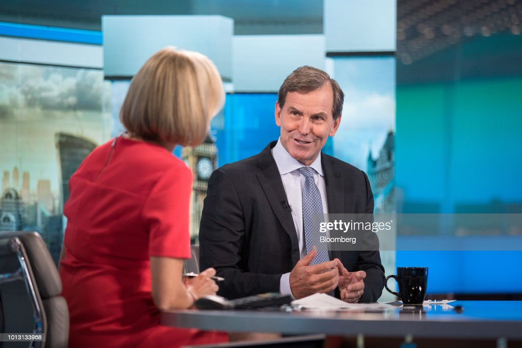Mike Wells, chief executive officer of Prudential Plc, right, gestures while speaking to Francine Lacqua, editor at large and anchor for Bloomberg Television, during a Bloomberg Television interview in London, U.K., on Wednesday, Aug. 8, 2018. Prudential reported that first-half profit from its Asian operations soared 14 percent to 1.02 billion pounds ($1.3 billion) on a constant exchange rate basis, ahead of a spinoff that would separate its U.K. operations from faster-growing markets elsewhere. Photographer: Simon Dawson/Bloomberg via Getty Images