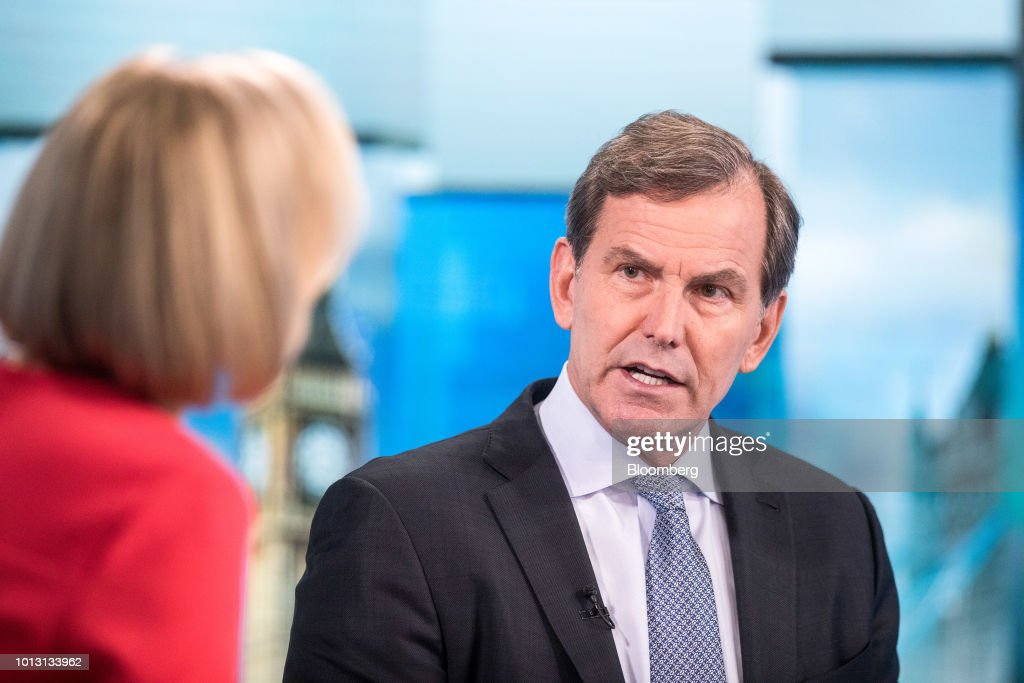 Mike Wells, chief executive officer of Prudential Plc, right, speaks to Francine Lacqua, editor at large and anchor for Bloomberg Television, during a Bloomberg Television interview in London, U.K., on Wednesday, Aug. 8, 2018. Prudential reported that first-half profit from its Asian operations soared 14 percent to 1.02 billion pounds ($1.3 billion) on a constant exchange rate basis, ahead of a spinoff that would separate its U.K. operations from faster-growing markets elsewhere. Photographer: Simon Dawson/Bloomberg via Getty Images