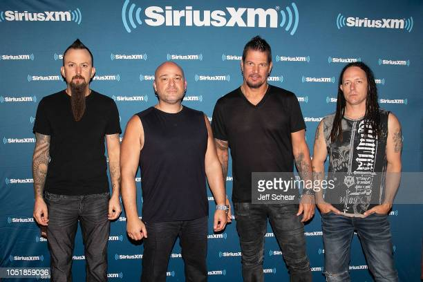 Mike Wengren David Draiman Dan Donegan and John Moyer of Disturbed attend SiriusXM Presents Disturbed Live From The Vic Theatre In Chicago on October...