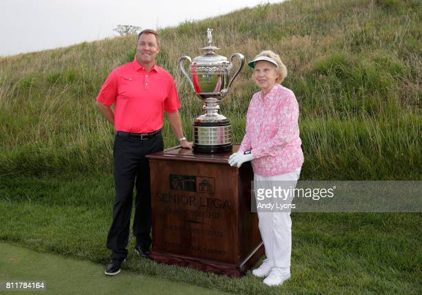 Mike Whan the LPGA Commissioner and Alice Dye pose with the winner's trophy before round one of the Senior LPGA Championship on July 10 2017 on The...