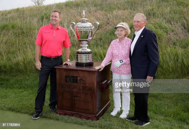 Mike Whan the LPGA CommissionerAlice Dye and Steve Ferguson Chairman of the Board for the Cook Group pose with the winner's trophy before round one...