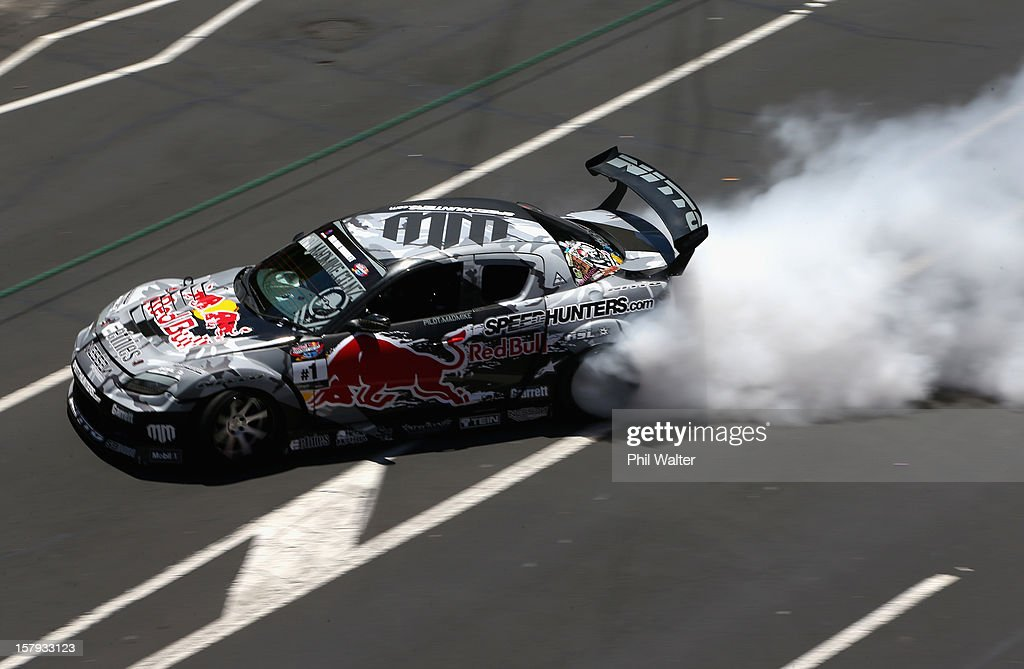 Mike Whiddett of New Zealand competes in the Red Bull Drift Shifters along Victoria Street on December 8, 2012 in Auckland, New Zealand.