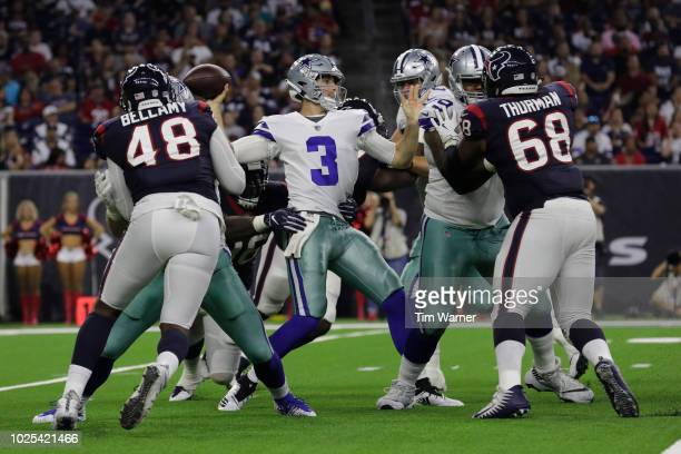 Mike White of the Dallas Cowboys looks to pass under pressure by Darius Kilgo of the Houston Texans in the second half of the preseason game at NRG...
