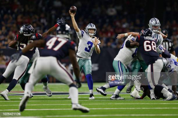 Mike White of the Dallas Cowboys throws a pass defended by Peter Kalambayi of the Houston Texans in the second half of the preseason game at NRG...