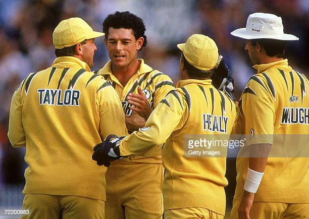 Mike Whitney of Australia celebrates taking a wicket with Mark Taylor during the Benson Hedges World Series 7th match between Australia and the West...