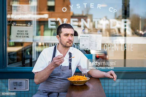 Mike Wiley a finalist for the James Beard award eats Andy Capp's Fries for a portrait shoot in front of Eventide Oyster Co on Fore Street Monday...