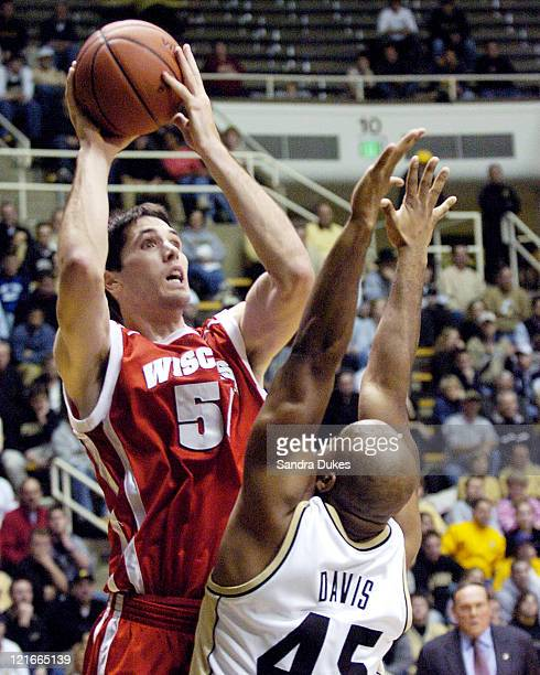 Mike Wilkinson shoots over Purdue's converted footballer Charles Davis in the first half of the game between Wisconsin and Purdue at the Mackey Arena...