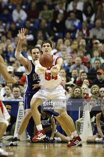 Mike Wilkinson the University of Wisconsin Badgers passes the ball against the Weber State University Wildcats during the NCAA Tournament 1st round...