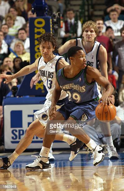 Mike Wilks of the Minnesota Timberwolves drives near Steve Nash and Dirk Nowitzki of the Dallas Mavericks during the game at the American Airlines...