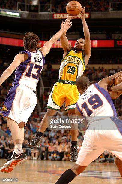 Mike Wilks of the Seattle SuperSonics shoots over the block of Steve Nash of the Phoenix Suns in an NBA game played on April 11 at US Airways Center...