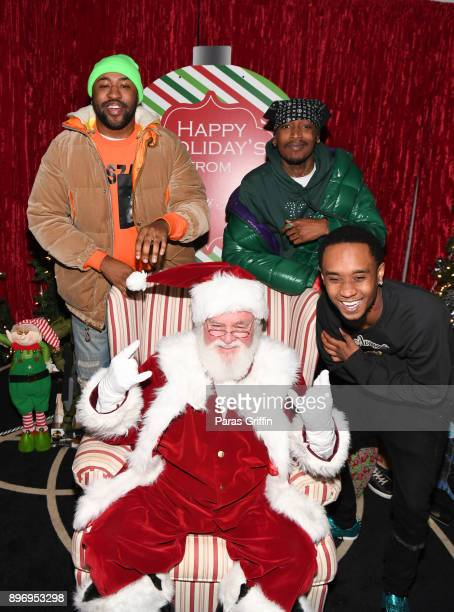 Mike Will Made It Eearz and Slim Jxmmi pose with Santa Claus at 2nd Annual Mike WiLL's Wish Fest at Andretti Indoor Karting and Games Marietta on...