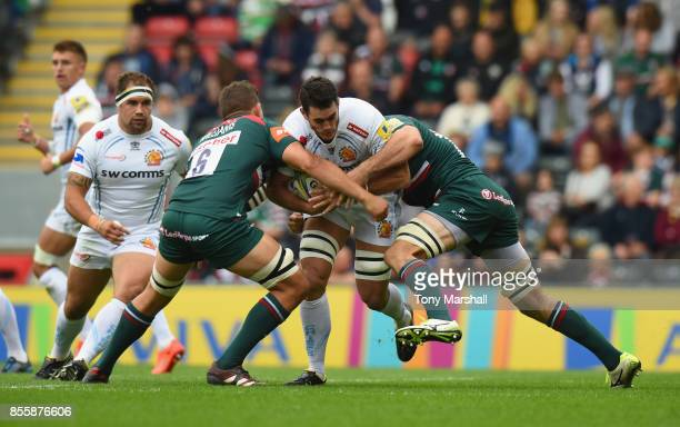 Mike Williams and Dom Barrow of Leicester Tigers tackle Dave Dennis of Exeter Chiefs during the Aviva Premiership match between Leicester Tigers and...