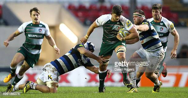 Mike Williams of Leicester is tackled by Leroy Houston during the Aviva Premiership match between Leicester Tigers and Bath at Welford Road on...