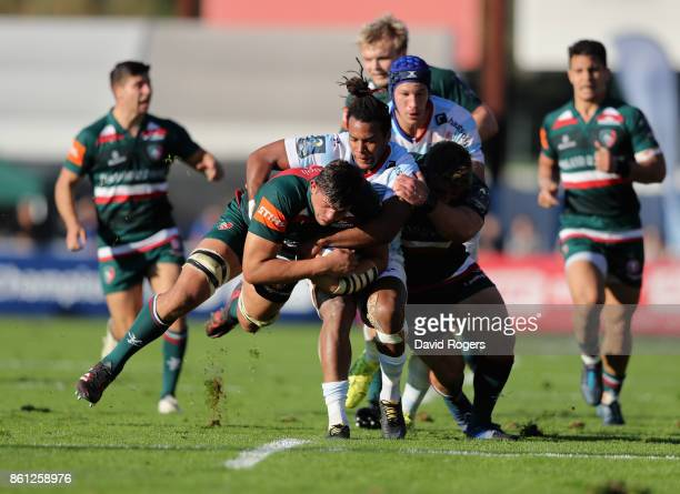 Mike Williams of Leicester is tackled by Teddy Thomas during the European Rugby Champions Cup match between Racing 92 and Leicester Tigers at Stade...