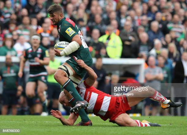 Mike Williams of Leicester is tackled by Willi Heinz during the Aviva Premiership match between Leicester Tigers and Gloucester Rugby at Welford Road...