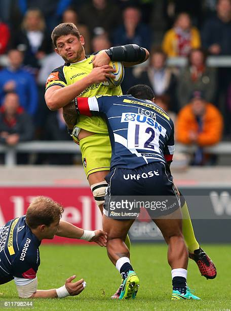 Mike Williams of Leicester Tigers is tackled by Johnny Leota of Sale Sharks during the Aviva Premiership match between Sale Sharks and Leicester...