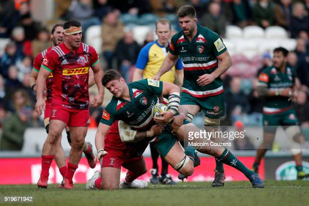 Mike Williams of Leicester Tigers is tackled during the Aviva Premiership match between Leicester Tigers and Harlequins at Welford Road on February...
