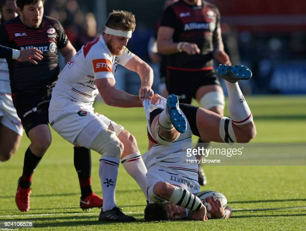 Mike Williams of Leicester Tigers lands on his head after catching a high ball during the Aviva Premiership match between Saracens and Leicester...