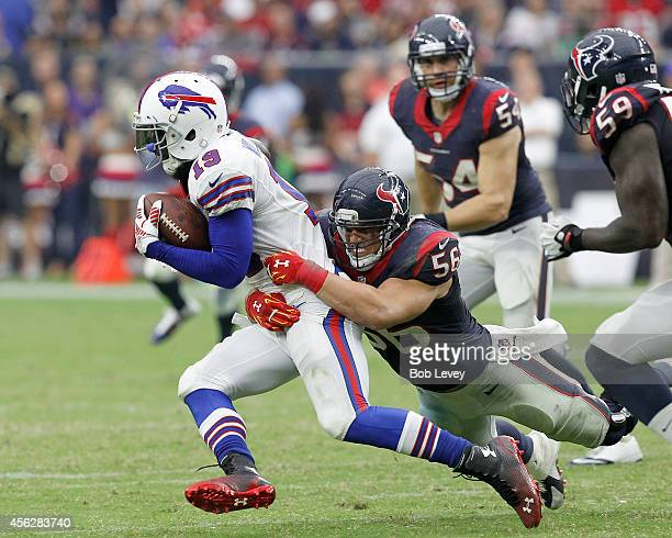 Mike Williams of the Buffalo Bills is tackled by Brian Cushing of the Houston Texans in the fourth quarter in a NFL game on September 28 2014 at NRG...