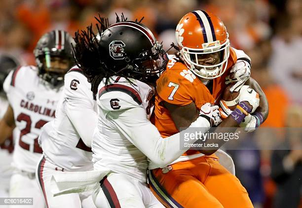 Mike Williams of the Clemson Tigers breaks free of a tackle by Jamarcus King of the South Carolina Gamecocks to score a touchdown during their game...