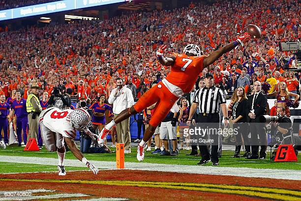 Mike Williams of the Clemson Tigers can't pull in a pass while being defended by Gareon Conley of the Ohio State Buckeyes during the first half of...