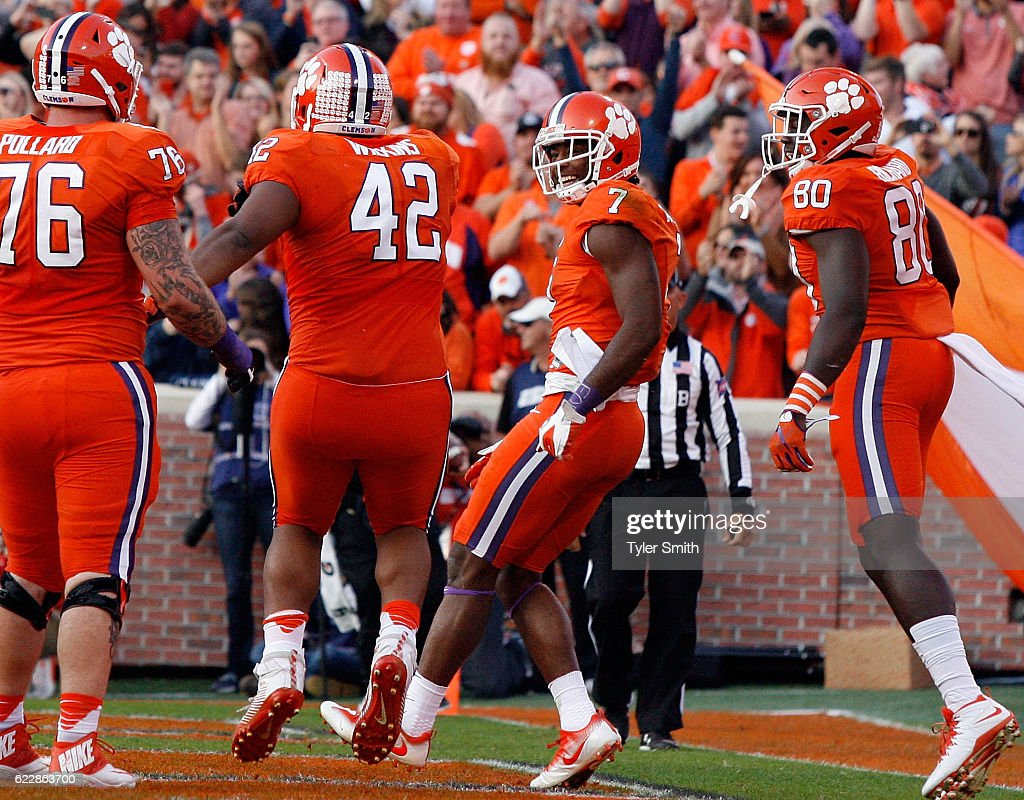 Mike Williams #7 of the Clemson Tigers reacts with Christian Wilkins #42 after scoring a touchdown during their game against the Pittsburgh Panthers at Memorial Stadium on November 12, 2016 in Clemson, South Carolina.