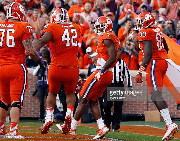 Mike Williams of the Clemson Tigers reacts with Christian Wilkins after scoring a touchdown during their game against the Pittsburgh Panthers at...