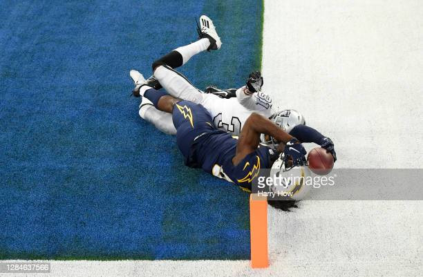 Mike Williams of the Los Angeles Chargers can't hold on to a fourth quarter touchdown catch against Isaiah Johnson of the Las Vegas Raiders at SoFi...