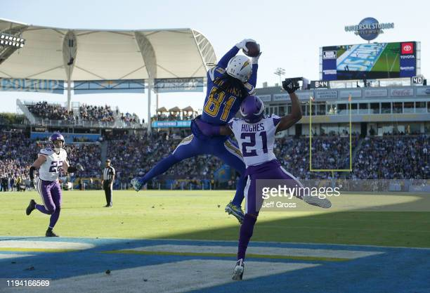 Mike Williams of the Los Angeles Chargers catches a pass for a touchdown over cornerback Mike Hughes of the Minnesota Vikings in the second quarter...