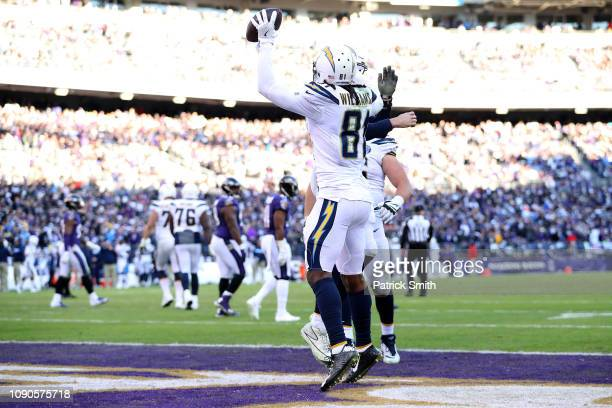 Mike Williams of the Los Angeles Chargers celebrates after scoring the two point conversion against the Baltimore Ravens during the fourth quarter in...