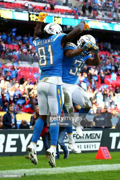 Mike Williams of the Los Angeles Chargers celebrates scoring his sides second touchdown with Austin Ekeler of the Los Angeles Chargers during the NFL...