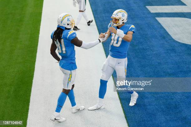 Mike Williams of the Los Angeles Chargers celebrates with Justin Herbert after Williams' touchdown during the first half against the New York Jets at...