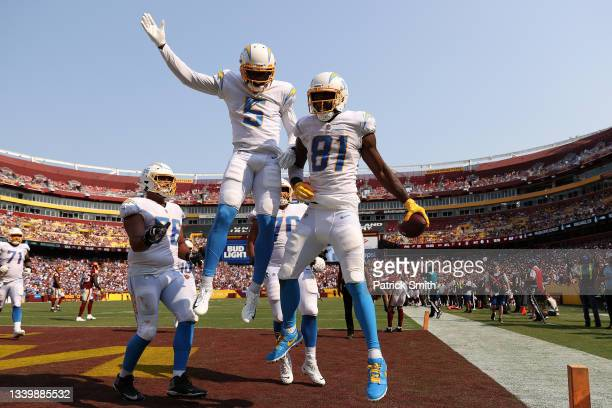 Mike Williams of the Los Angeles Chargers celebrates with teammates after catching a three yard touchdown reception during the fourth quarter against...