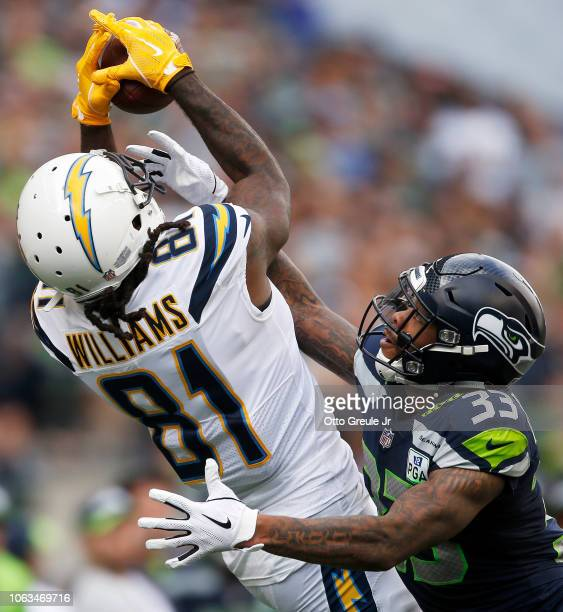 Mike Williams of the Los Angeles Chargers makes a catch while being guarded by Tedric Thompson of the Seattle Seahawks in the second quarter at...