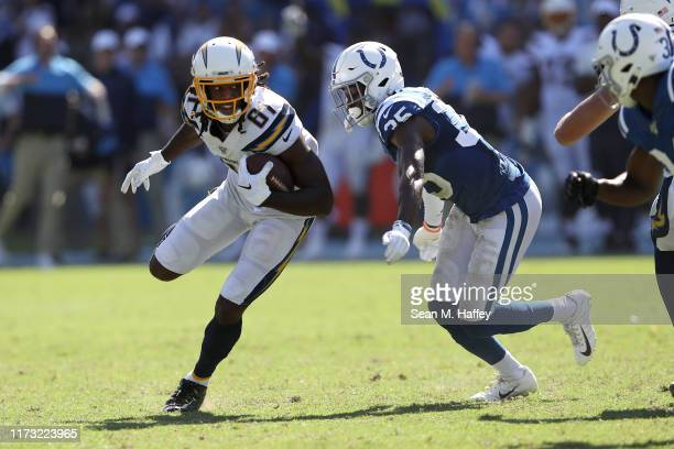 Mike Williams of the Los Angeles Chargers runs past Pierre Desir of the Indianapolis Colts on a short pass play during the second half of a game at...