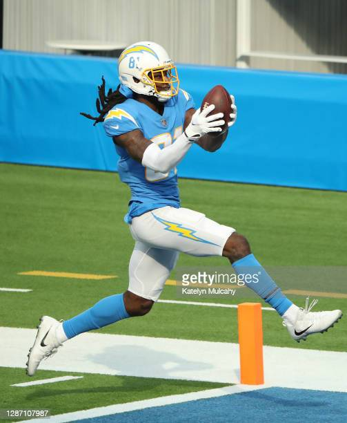 Mike Williams of the Los Angeles Chargers runs the ball into the end zone for a touchdown during the first half against the New York Jets at SoFi...