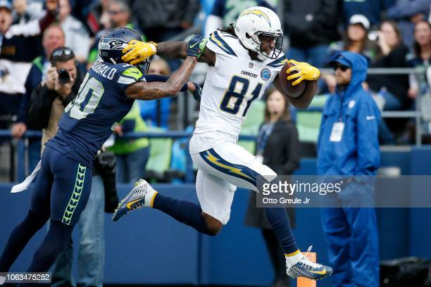 Mike Williams of the Los Angeles Chargers scores a touchdown past Bradley McDougald of the Seattle Seahawks in the second quarter at CenturyLink...