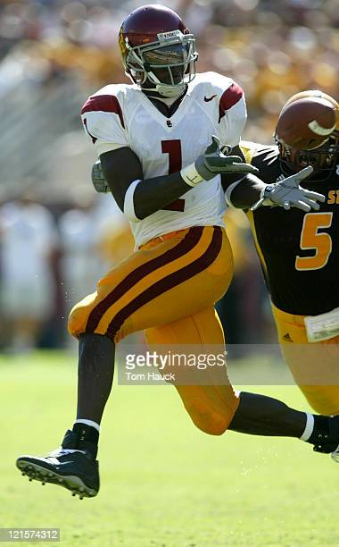 Mike Williams of the USC Trojans makes a catch in the third quarter against Justin Burks of the Arizona State Sun Devils at Sundevil Stadium in...