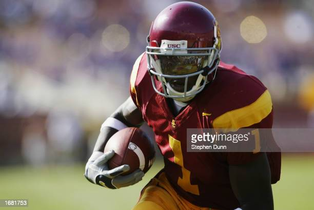 Mike Williams of the USC Trojans runs for a touchdown during the Pac-10 Conference football game against the Washington Huskies at the Los Angeles...