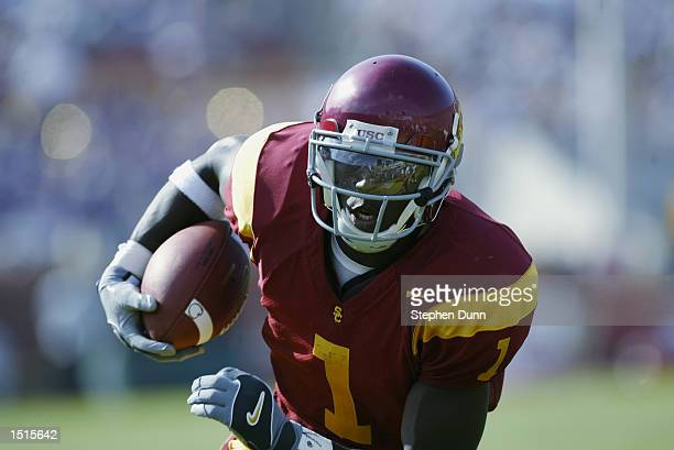 Mike Williams wide receiver for USC Trojans carries the ball for a touchdown after a reception versus the Washington Huskies on October 19 2002 at...
