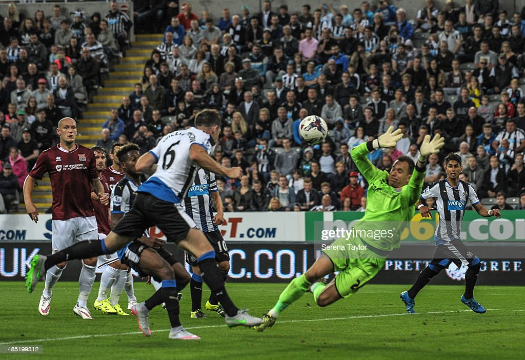 Mike Williamson (L) of Newcastle scores the fourth goal for Newcastle during The Capital One Cup second round match between Newcastle United and Northampton Town at St.James Park on August 25, 2015, in Newcastle upon Tyne, England.